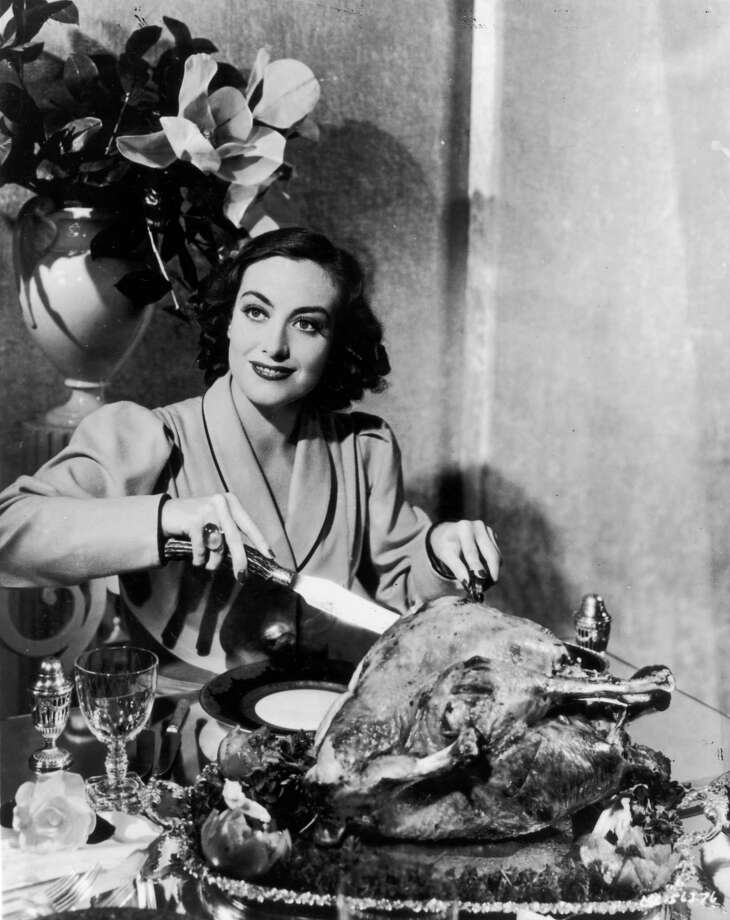 Here's actress Joan Crawford (1908 - 1977) carving a Thanksgiving turkey for a publicity shot, circa 1930. Photo: General Photographic Agency, Getty Images / Hulton Archive