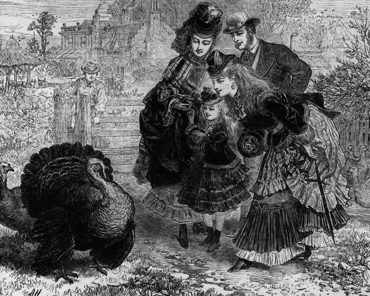 A prosperous looking family takes a closer look at a particularly plump turkey at a farm in this ima