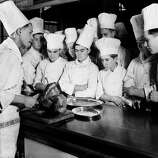 Trainee chefs watch a display of turkey carving at the Westminster Technical Institute in Vincent Square, London, on Dec. 23, 1937.