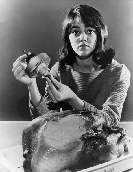 Julie Hacker holds an RCA-developed microwave oven electron tube on March 23, 1971, above a 16-pound
