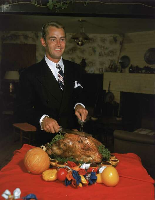 Actor Alan Ladd (1913 - 1964) carves a Thanksgiving turkey in a promotional portrait from the 1950s. Photo: Hulton Archive, Getty Images / 2005 Getty Images