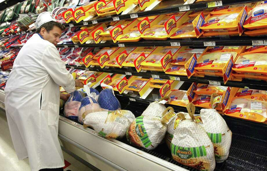 Long gone, of course, are the days of turkeys hanging in rows on hooks. These days, most of us get our turkeys this way. Here, meat wrapper Rick Shapiro restocks and arranges turkeys Nov. 26, 2002 at a Jewel-Osco food store in Des Plaines, Ill. Photo: Tim Boyle, Getty Images / 2002 Getty Images