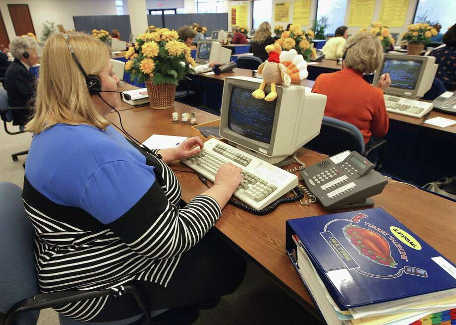 And once we get our turkeys home, we can get advice from Butterball Turkey Talk-Line specialists such as Jan Allen, left, shown answering questions on Nov. 24, 2003 in Downers Grove, Ill. Photo: Tim Boyle, Getty Images / 2003 Getty Images