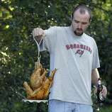 One easy piece of advice is to make sure you really know what you're doing if you want to deep-fry a turkey. Here, John Wojtasik removes a turkey from hot peanut oil on Nov. 27, 2003, at Markham Park in Fort Lauderdale, Fla.