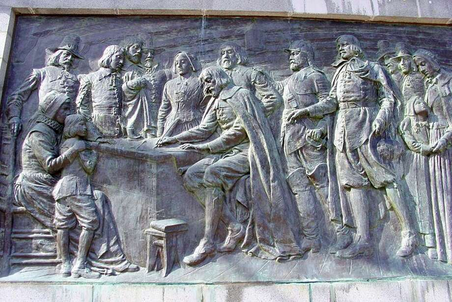 The above bas relief depicts the signing of the Compact by the Pilgrims aboard the Mayflower in 1620. The memorial is located in Provincetown, Mass.