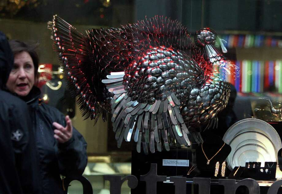 A woman looks at a turkey made of silver on display at a store ahead of Thanksgiving  celebrations in New York on Nov. 20, 2007. Photo: EMMANUEL DUNAND, AFP/Getty Images / 2007 AFP
