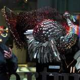 A woman looks at a turkey made of silver on display at a store ahead of Thanksgiving  celebrations in New York on Nov. 20, 2007.
