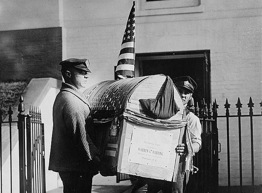 A Thanksgiving turkey arrives at the White House bearing the name of President Warren G. Harding on the crate in 1921. It was a gift from H.W. Mason of Crystal Springs, Miss. Turkey gifts to the president on Thanksgiving go way back. The tradition of pardoning the birds is more recent. Photo: National Photo Company Collection (Library Of Congress)