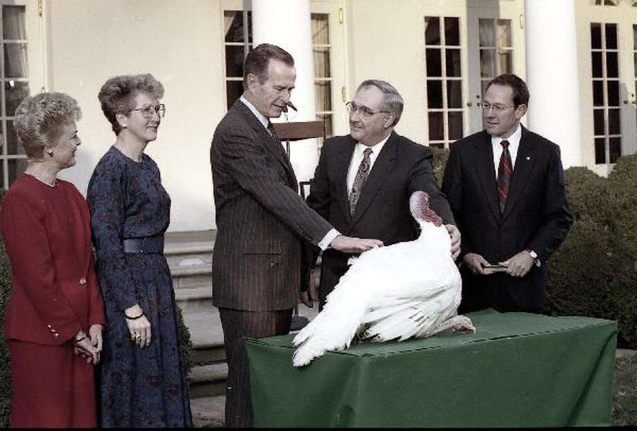 President George H.W. Bush pardons the Thanksgiving turkey on Nov. 25, 1991. Photo: George Bush Presidential Library And Museum