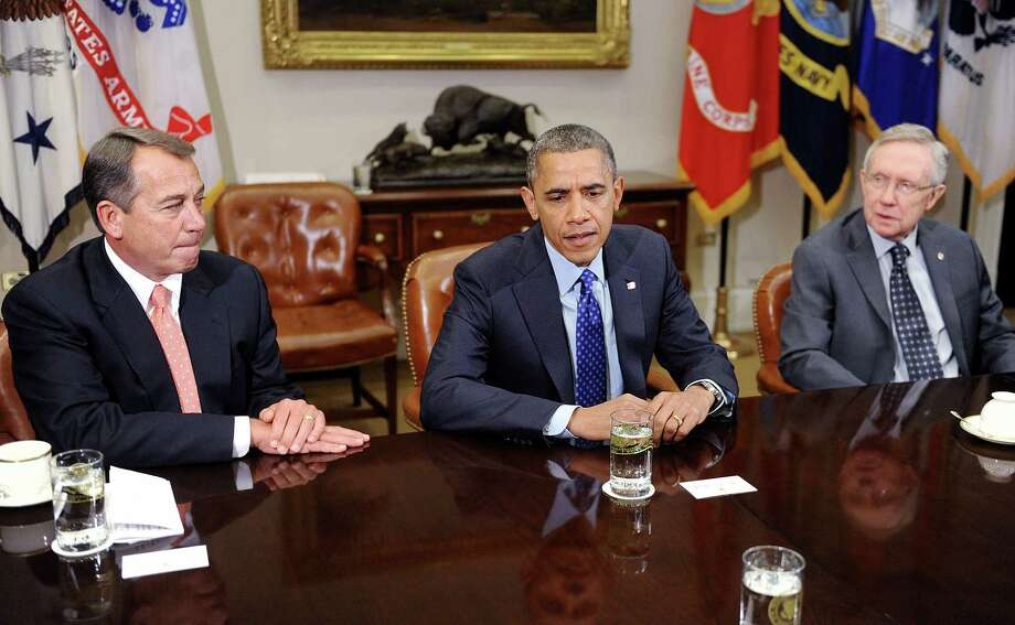 President Barack Obama hosted congressional leaders, including House Speaker John Boehner, left, and Senate Majority Leader Harry Reid at a bipartisan meeting last Friday in the White House. Photo: Olivier Douliery / © 2012 Bloomberg Finance LP