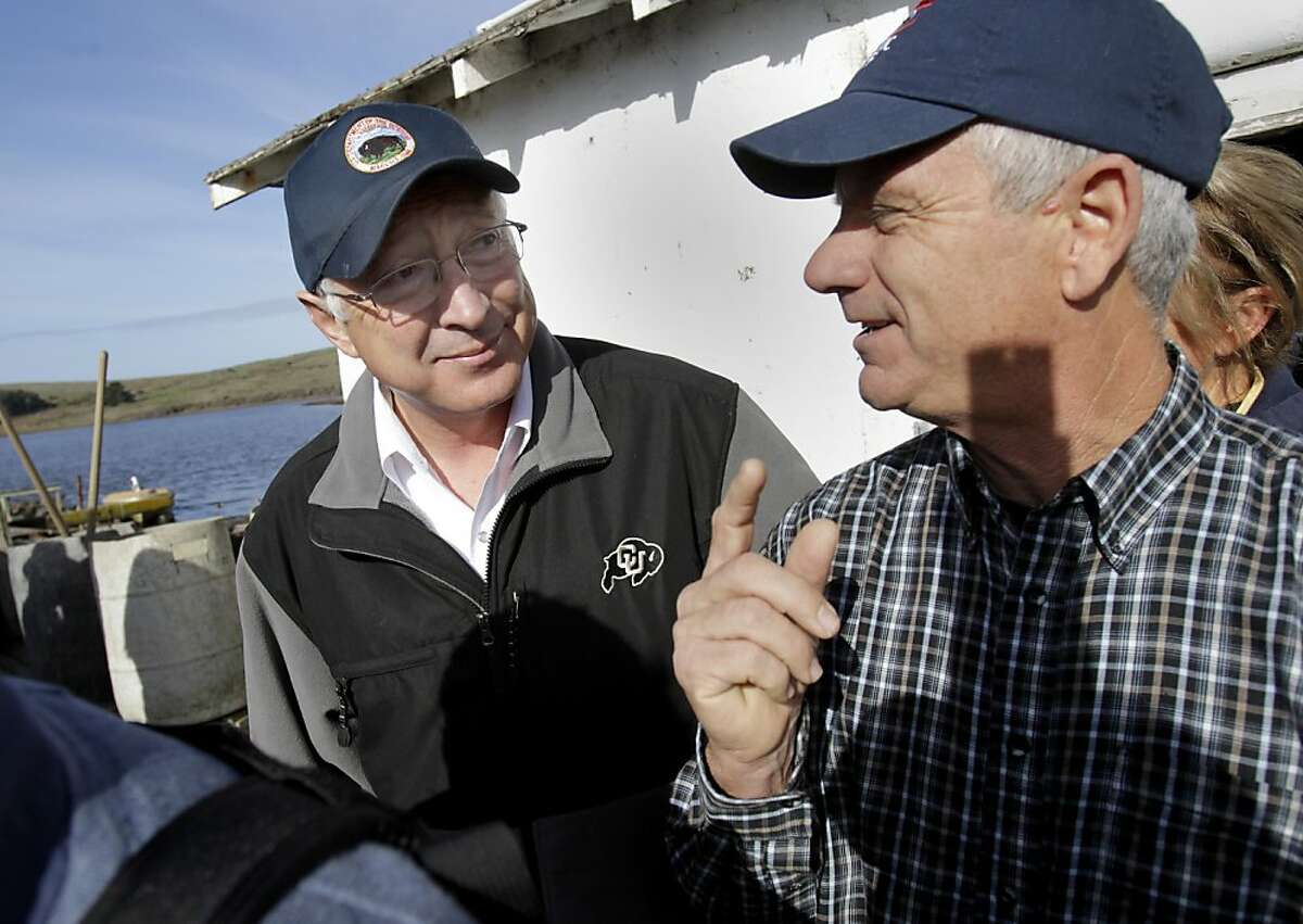 Secretary Salazar (left) got a tour of the oyster company by owner Kevin Lunny (right). US Secretary of the Interior Ken Salazar visited Drakes Bay Oyster Company Wednesday November 21, 2012 as he is trying to decide whether the oyster farm belongs in a national park setting.