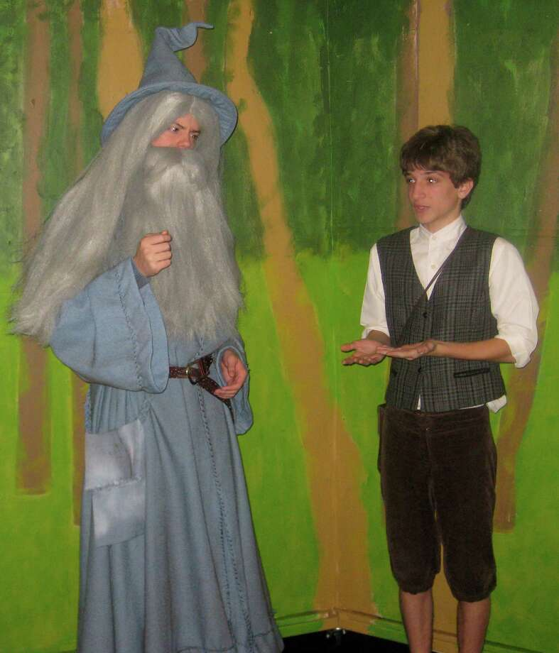 "Will Powers as Gandalf, left, and James Purcell as Bilbo in a scene from Fairfield Ludlowe High School's production of ""The Hobbit."" A total of three performances are scheduled Nov. 20 and Dec. 1. Photo: Contributed Photo / Fairfield Citizen contributed"