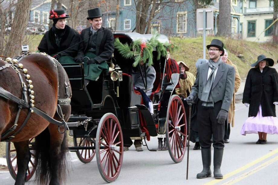 As seen here, participants and visitors to the annual Victorian Christmas Celebration in the Schoharie County village of Sharon Springs embrace the event?s theme, with period-appropriate attire and transportation.