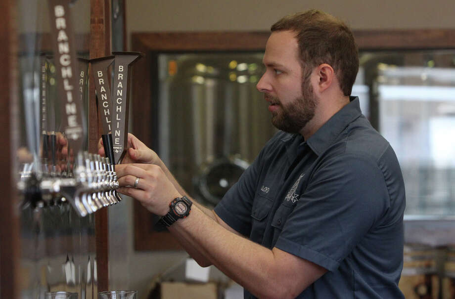 Jason Ard, owner of Branchline Brewing Co., works on newly installed equipment at his place of business. His brewery focuses on craft beers utilizing local and regional ingredients when possible. Photo: JOHN DAVENPORT, San Antonio Express-News / ©San Antonio Express-News