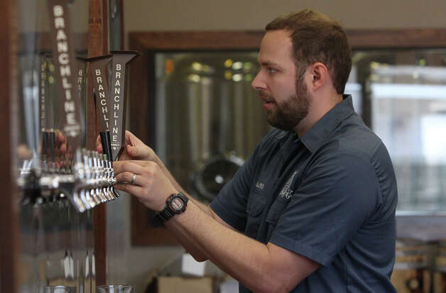 Jason Ard, owner of Branchline Brewing Co., works on newly installed equipment at his place of business. His brewery focuses on craft beers utilizing local and regional ingredients when possible. Photo: JOHN DAVENPORT, San Antonio Express-News / ©San Antonio Express-News/Photo Can Be Sold to the Public