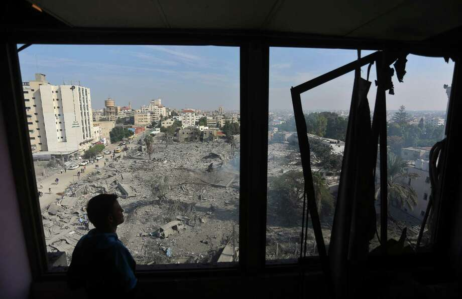 A Palestinian man inspects the roof of a building after an Israeli airstrike in Gaza City. Letter writers share their opinons on the conflict between Hamas and Israel.  Photo: Wissam Nassar, New York Times / NYTNS