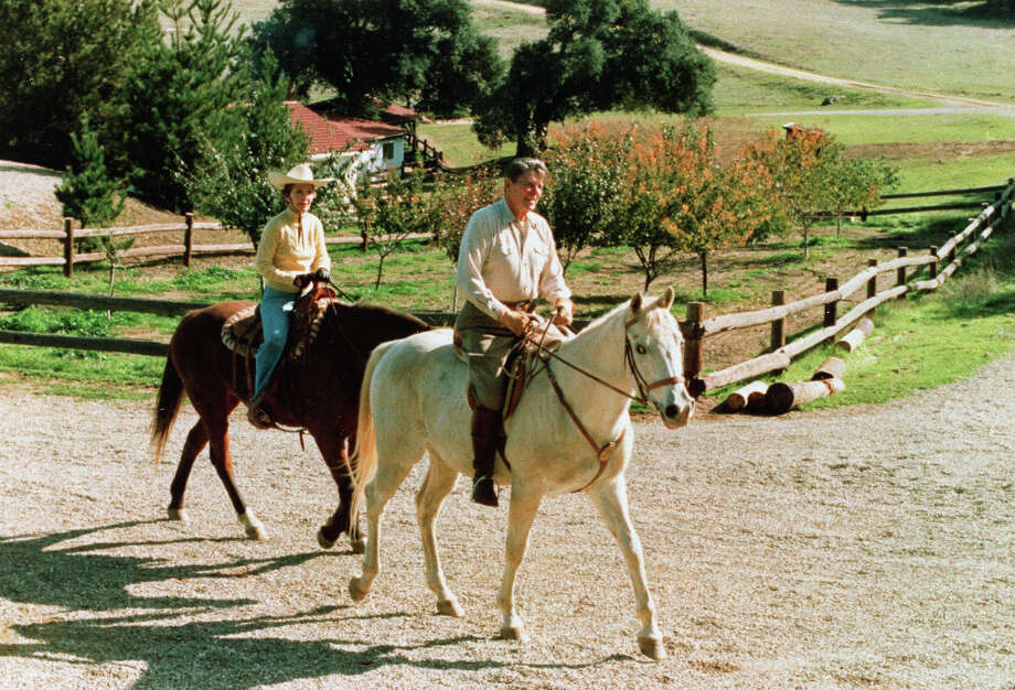 U.S. President Ronald Reagan and first lady Nancy Reagan, left, go for a ride on horseback at their ranch, Rancho del Cielo, near Santa Barbara, Ca., Thanksgiving Day, Nov. 25, 1982.   (AP) Photo: ASSOCIATED PRESS / AP1982