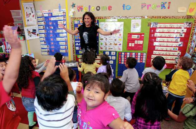 "Teacher Sara M. Estrada works with her preschoolers at Lion Lane School in Houston. ""We have some of the wealthiest people in Houston on the south side (of the Spring Branch ISD) and really high poverty on the north side,"" says Sharee Cantrell, the school's director. Photo: Billy Smith II, Houston Chronicle / © 2012 Houston Chronicle"