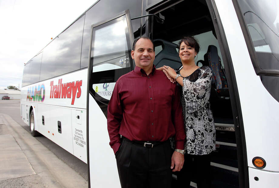 City Tours President Edward Torres stands with his wife, Annette, the company's vice-president. Photo: Kin Man Hui, San Antonio Express-News / ©2012 San Antonio Express-News