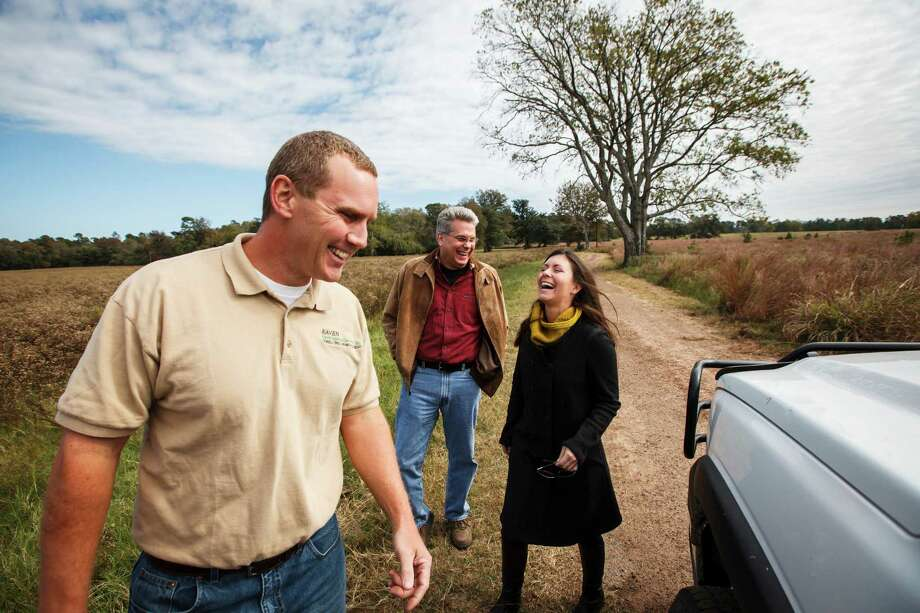 Sarah Mitchell, executive director of the Cook's Branch Conservancy, right, shares a laugh with Eric Keith, left, and Joe Hamrick, center, while at the 5,650 acres in Montgomery County north of Houston, Wednesday, Nov. 14, 2012, in Montgomery.  Operated as a program of the Cynthia and George Mitchell Foundation, Cook's Branch Conservancy offers a rare glimpse into what nearly a century of regeneration looks like in the Pineywoods region of East Texas. Photo: Michael Paulsen, Houston Chronicle / © 2012 Houston Chronicle