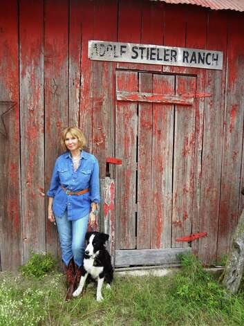 The Home Ranch near Comfort has been home to generations of the Stieler family, including Becky Crouch Patterson. Here, she's with her dog, Zorro. Photo: Steve Bennett, San Antonio Express-News