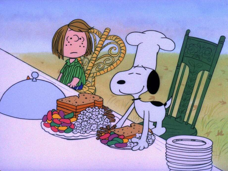 """CHARLIE BROWN THANKSGIVING, A CB_THANKS003 - 'A CHARLIE BROWN THANKSGIVING' - With Thanksgiving coming up, Charlie Brown wants to do something special for the gang. However, the dinner he arranges is a disaster when the caterers, Snoopy and Woodstock, prepare toast and popcorn as the main dish. Humiliated, it will take all of Marcie's persuasive powers to salvage the holiday for Charlie Brown in, 'A Charlie Brown Thanksgiving' airing on FRIDAY, NOVEMBER 16 (8:00-8:30 p.m., ET), on the ABC Television Network. (-1973 United Features Syndicate Inc.)    HOUCHRON CAPTION (11/16/2001):  Peppermint Patty, Snoopy and the rest of the gang prepare for a feast in """"A Charlie Brown Thanksgiving,"""" on ABC/Channel 13. / handout web"""