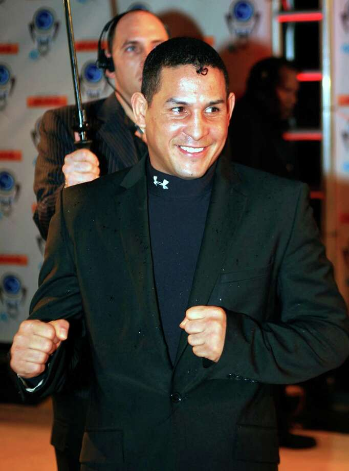 "FILE - In this Dec. 14, 2006, file photo, Hector ""Macho"" Camacho arrives for an event in Miami Beach, Fla. Police in Puerto Rico say former boxing champion Camacho has been shot and critically wounded. Camacho was shot in the face while in a car outside a bar in Bayamon, one of the cities that make up the San Juan metropolitan area. A statement from police in Bayamon said he was shot Tuesday night, Nov. 20, 2012. (AP Photo/Luis M. Alvarez, File) Photo: Luis M. Alvarez"