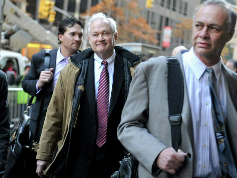 NHL Players' Association executive director Donald Fehr, center, arrives for labor talks at NHL headquarters in New York with his brother, NHLPA counsel Steven Fehr, right, Wednesday, Nov. 21, 2012, in New York. (AP Photo/ Louis Lanzano) Photo: Louis Lanzano