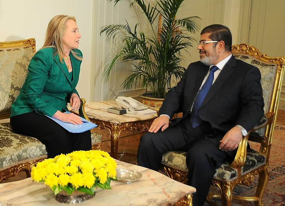 Secretary of State Hillary Rodham Clinton and Mohammed Morsi, Egypt's president, meet in Cairo. Photo: Anonymous, Associated Press
