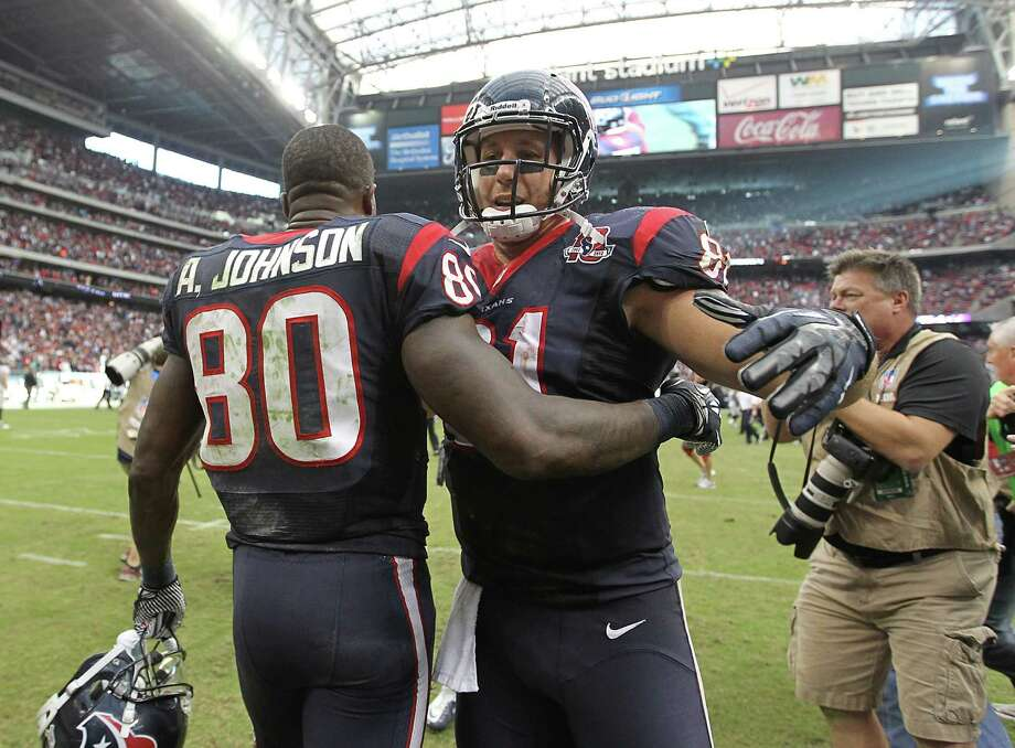 Houston Texans wide receiver Andre Johnson (80) reacts with tight end Owen Daniels (81) after Johnson's game winning touchdown during overtime of an NFL game at Reliant Stadium, Sunday, Nov. 18, 2012, in Houston. Photo: Karen Warren, Houston Chronicle / © 2012  Houston Chronicle