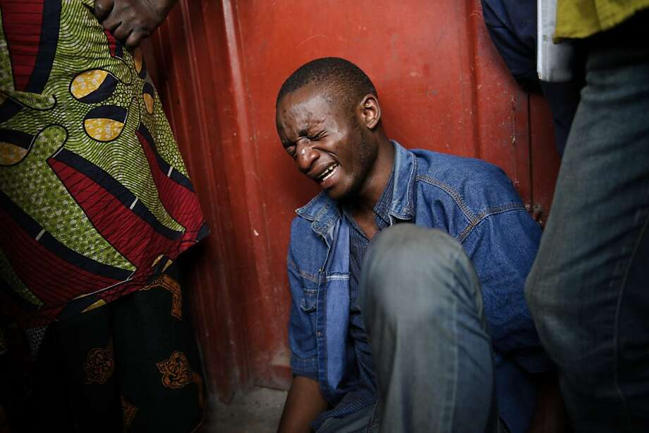 Lokuli Loleko Prince reacts to finding the body of his father in the Ndosho district of Goma, an eastern Congolese city now under the control of rebels. Photo: Phil Moore, AFP/Getty Images