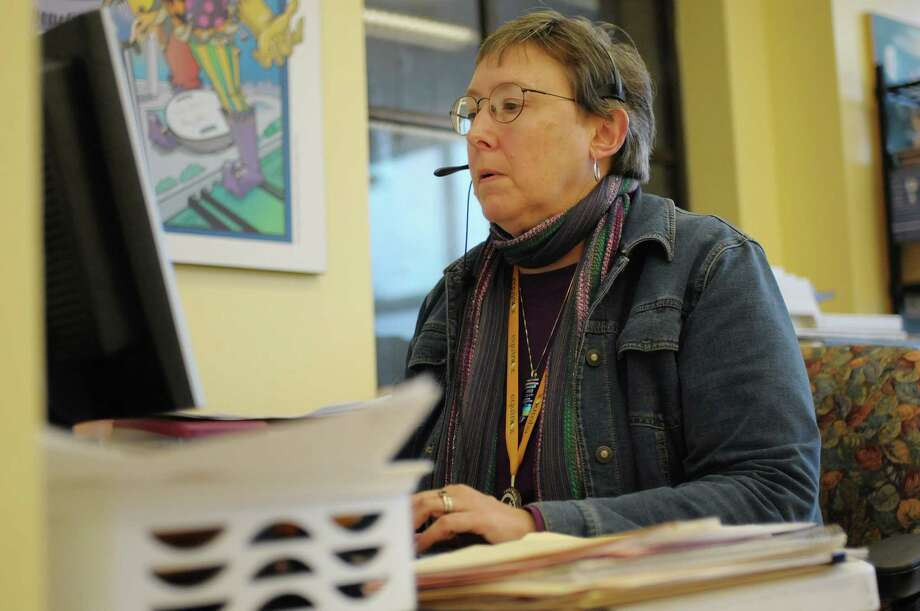 Nancy Virkler, a volunteer at Equinox works at her desk at the Equinox offices on Tuesday, Nov. 13, 2012 in Albany, NY.  (Paul Buckowski / Times Union) Photo: Paul Buckowski