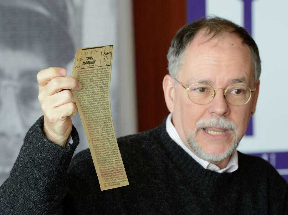 "Gregory Maguire ""76 and Albany-native holds up a tear sheet of one of his father's Times Union columns as speaks at The University at Albany during a brief ceremony held on the campus in Albany, N.Y. Nov 20, 2012. The Best- selling author of 'Wicked: The Life and Times of the Wicked Witch of the West' which spawned the Broadway hit Wicked turned over 50 years of personal and professional papers, manuscripts, documents , diaries and memorabilia to the SUNYA Library.     (Skip Dickstein/Times Union) Photo: Skip Dickstein / 00020166A"