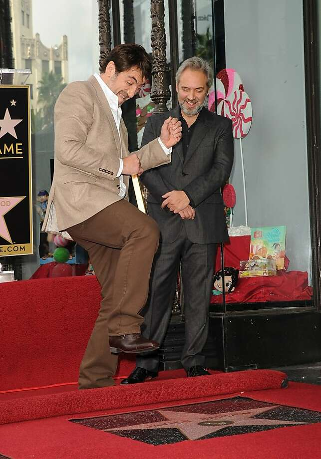 "Javier Bardem (left) is pretty excited about getting a star on the Hollywood Walk of Fame this month. Sam Mendes, his director in ""Skyfall,"" is happy about it, too. Bardem's star is next to the one honoring his wife, Penelope Cruz. Photo: Jason Merritt, Getty Images"