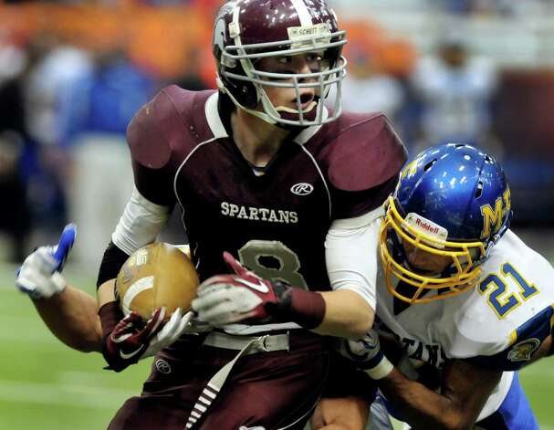 Burnt Hills' Eric Dillon (8), left, carries the ball as Maine-Endwell's Luis Uceta (21) defends during their Class A state championship football game on Friday, Nov. 25, 2011, at the Carrier Dome in Syracuse, N.Y. (Cindy Schultz / Times Union) Photo: Cindy Schultz
