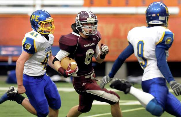 Burnt Hills' Eric Dillon (8), center, carries the ball as Maine-Endwell's Colin Reynolds (41), left, and Robert Allen (9) defendsduring their Class A state championship football game on Friday, Nov. 25, 2011, at the Carrier Dome in Syracuse, N.Y. (Cindy Schultz / Times Union) Photo: Cindy Schultz