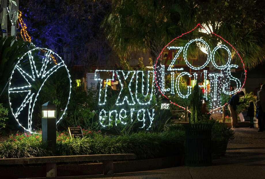 The Houston Zoo, 6200 Hermann Park Drive. Early tour of spectacular Zoo Lights allows its biggest donors a sneak peek of the holiday festival. It opens to the public 6 p.m.-10 p.m., Nov. 23-Jan. 5. ID: Lights at entrance. Friday 11/16/12 (Craig H. Hartley/For the Chronicle) Photo: Craig Hartley, Freelance / Copyright: Craig H. Hartley