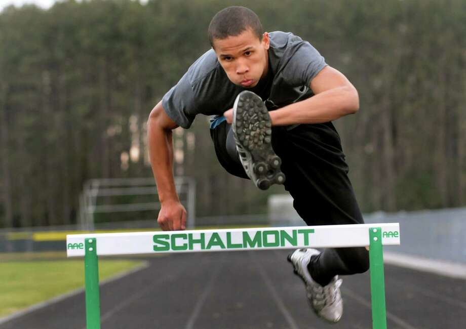 Devon Willis jumps a hurdle on Tuesday, Nov. 20, 2012, at Schalmont High in Rotterdam, N.Y. (Cindy Schultz / Times Union) Photo: Cindy Schultz / 00020198A