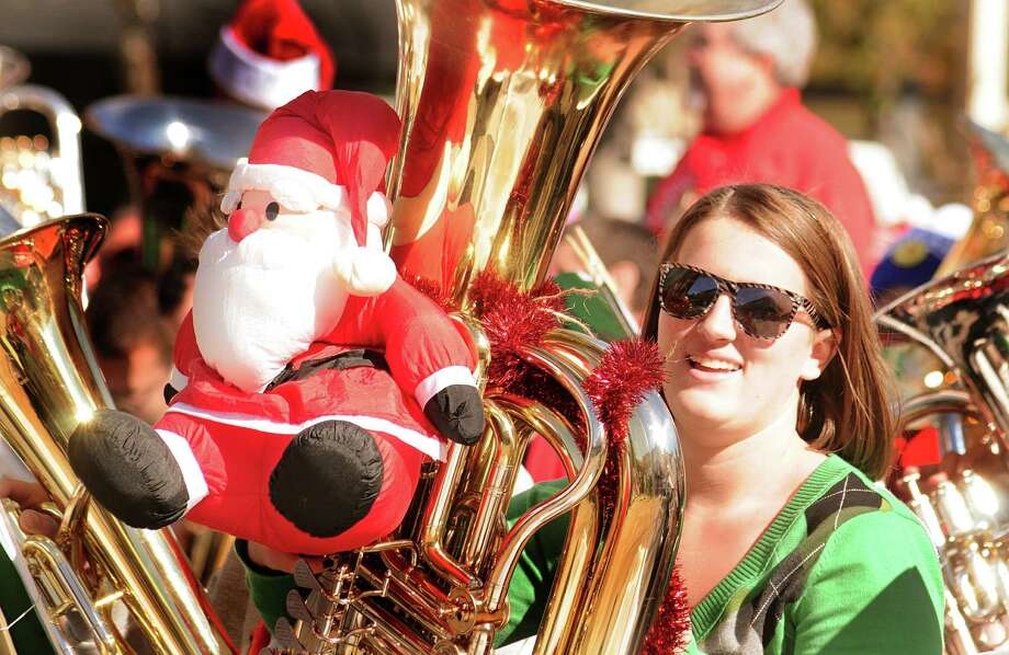 Courtney Reid, of Katy 77494, with her tuba, decorated with Santa, during the Houston Tuba Christmas performance at Central Park in The Woodlands. Almost 100 tuba and Euphonium players, from across the Houston area,  performed during the concert. Photo: David Hopper, Freelance / freelance