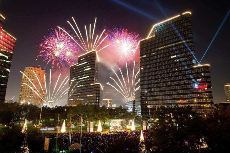 Fireworks explode over the stage during the  26th Annual Uptown Holiday Lighting on Thursday, Nov. 24, 2011, in Houston. ( Smiley N. Pool / Houston Chronicle ) Photo: Smiley N. Pool, Staff / Copyright: Houston Chronicle