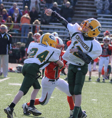 Crushers QB Fin Signer throws a 28-yard pass completion. November 2012. Photo: Contributed Photo