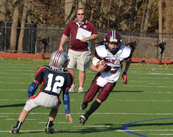 Bantam Bulldog William Montesi (63) runs for a positive gain. November 2012. Photo: Contributed Photo