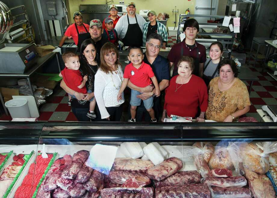 Michael Cruz, center, has a real family business. Ten family members work at Pete's Fine Meats and the shop has many long-time employees. It was shuttered by fire in January and didn't reopen until a few days ago. Photo: Johnny Hanson, Staff / © 2012  Houston Chronicle