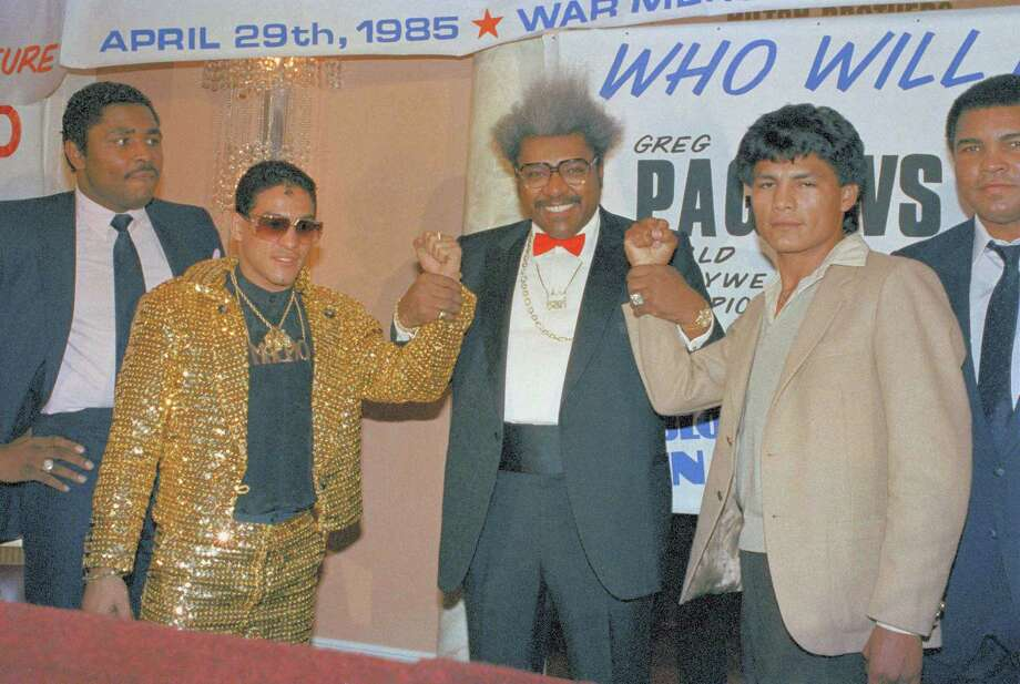 Hector Camacho, left, always dressed to be noticed. Here, promoter Don King, holds up the fists of Camacho and Roque Montoya, the Mexican lightweight champ on March 7, 1985. They would fight on April 29 of that year, with Camacho winning a 12-round unanimous decision. Photo: Marty Lederhandler, Marty Lederhandler/Associated Press / AP