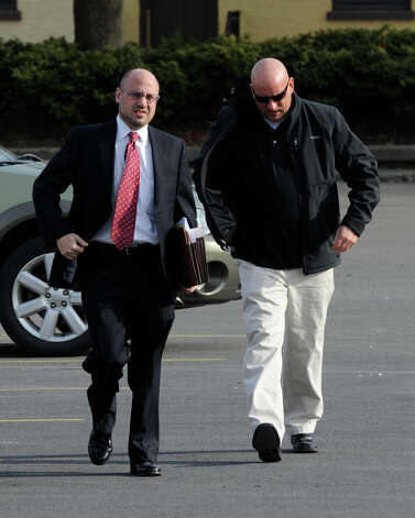 Albany Police Officer Brian Lutz, right,  arrives at the Department of Motor Vehicles building in downtown Albany, N.Y. accompanied by his lawyer Andrew Sofranko for his hearing before an administrative law judge regarding the status of his drivers license after refusing a breath-alcohol test April 8, 2011.  (Skip Dickstein / Times Union) Photo: SKIP DICKSTEIN
