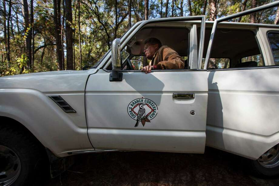 Joe Hamrick, a project manager with Raven Environmental Services, gets into a vehicle while driving through the 5,650 acres of Cook's Branch Conservancy in Montgomery County north of Houston, Wednesday, Nov. 14, 2012, in Montgomery. Photo: Michael Paulsen, Houston Chronicle / © 2012 Houston Chronicle