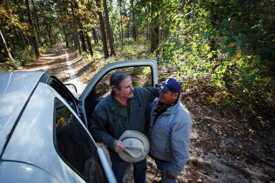 Scott Mitchell, son of George and Cynthia Mitchell, talks with a grounds keeper at the 5,650 acres of Cook's Branch Conservancy in Montgomery County north of Houston, Wednesday, Nov. 14, 2012, in Montgomery. Photo: Michael Paulsen, Houston Chronicle / © 2012 Houston Chronicle