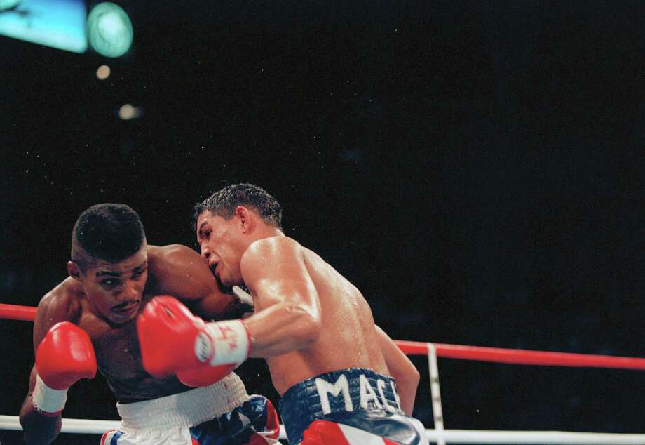 "Hector ""Macho"" Camacho, right, lands a blow to Felix Trinidad in the third round of their IBF Welterweight Championship, Jan. 29, 1984, in Las Vegas. Trinidad won in a unanimous decision. Photo: Jeff Scheid, AP / AP"