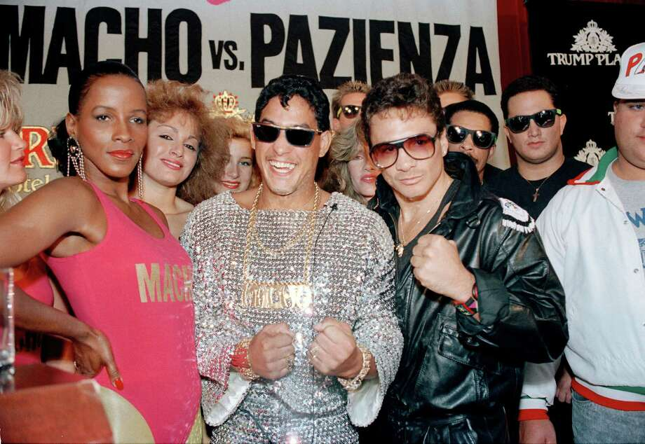 "Hector ""Macho"" Camacho, center, and Vinny Pazienza, right, pose amid their news conference entourages in New York on Oct. 10, 1989 as they promote their WBA Junior Welterweight title fight. Camacho won a 12-round unanimous decision against Pazienza on Feb. 3. Photo: Gerald Herbert, AP / AP"