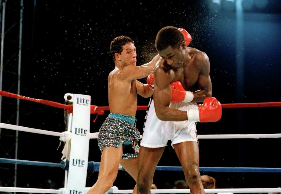 "Hector ""Macho"" Camacho, left, strikes a blow to the head of opponent Cornelius Boza Edwards during the World Boxing Council Lightweight title fight in Miami Beach, Fla., Sept. 27, 1986. Camacho retained his title in a unanimous decision after twelve rounds. Photo: Kathy Willens, AP / AP"